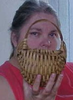 Katie, the basket maker, showing off an Appalachian Egg Basket